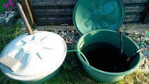 Regenfässer im Boden mit Gardena Pumpe